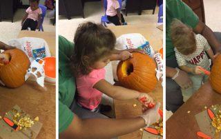 Young Preschoolers enjoying pumpkin carving